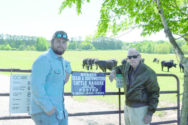 Tanner Ezell (left) will be recognized as an Outstanding Conservationist for his Cattle & Hay Operation by Roland Adams (right), director of zone 2 of the Cherokee County Soil & Water Conservation District #427.