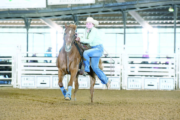 Photo provided by mark king Briley King of Rusk, races against the clock to secure the fastest tie in a recent event. King will travel to South Dakota at the end of the month to participate in the 14th annual National Junior High Finals rodeo. King secured her place on the team by finishing second in the goat tying event in state finals.
