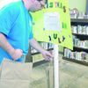Photo by Cristin Parker Gallatin resident and library volunteer Daryl Chandler hanging bags to be filled during the Christmas in July donation drive, benefitting the Rainbow Room of Cherokee County. Jacksonville, Alto and Rusk libraries are offering the bags for the drive through the month of July.