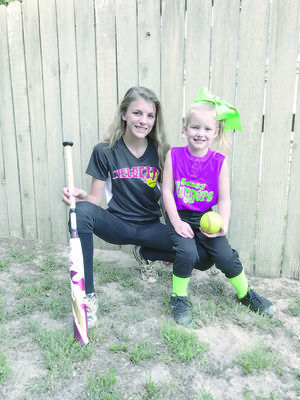 Photo by Tara Tatarski Sisters Trinity Crosby, left, and Rebecca Hood play on little league softball teams in Rusk that earned state playoff spots. Playoff games will begin in Rusk the week of July 9.