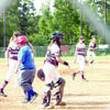 Photo by Cristin Parker Team members of the Corsicana Lady Texas Rangers and the Lovelady Lion Drive conclude their match up during the 15U softball tournament going on this week at the Rusk Lion's Baseball/Softball complex. The Lion Drive beat the Lady Rangers Monday morning, 16-0.