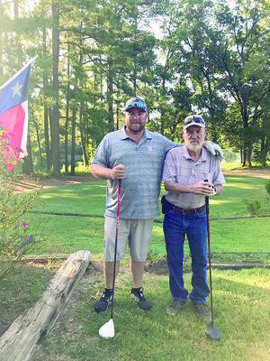 Courtesty Photo Cord Stover, left, and Don Goff took home the title of second place Championship flight during the father son/daughter gold tournament held at Birmingham Forest Golf Course on Saturday, Aug. 4. Birmingham Forest Golf Course is a family owned, nine hole course located in Rusk.