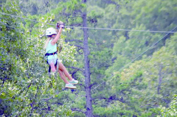 Birthday girl Carolyn McIntyre zipping through the trees.