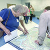 Photo courtesy Penny Hawkins Jacksonville area resident peruse maps and information regarding the Texas Department of Transportation's proposed routes to take U.S. Highway 69 around the city during a meeting held last week at the Norman Activity Center in Jacksonville.