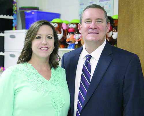 Courtesy Photo Pictured, from left, are Karyn Ard and Bobby Dyess, THS principal.