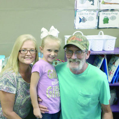 Chloe Devries, center, with her grandmother Michelle Hall and great-grandfather Michael Dominy, all of Rusk.