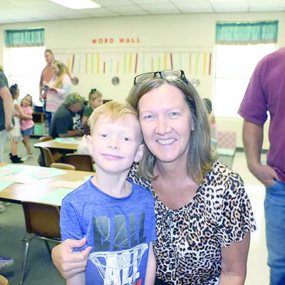 Kingston Gonzalez with his Gigi, Rhonda Dover during the Grandparent's Day cookie social held at his school.