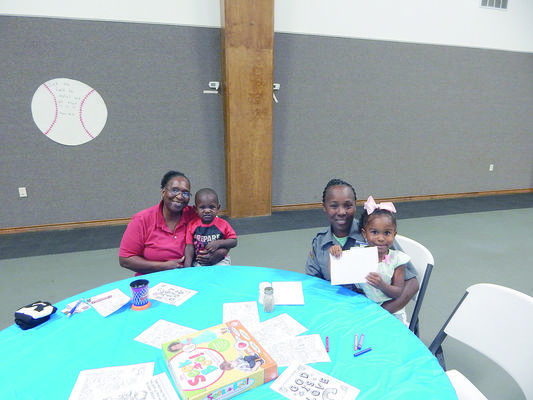 Enjoying the festivities at East Side Baptist Academy's  celebration on  Tuesday, Sept. 11  are Glenda Hackney, Jacob Williams, Jalane Green and Kholee Warren.