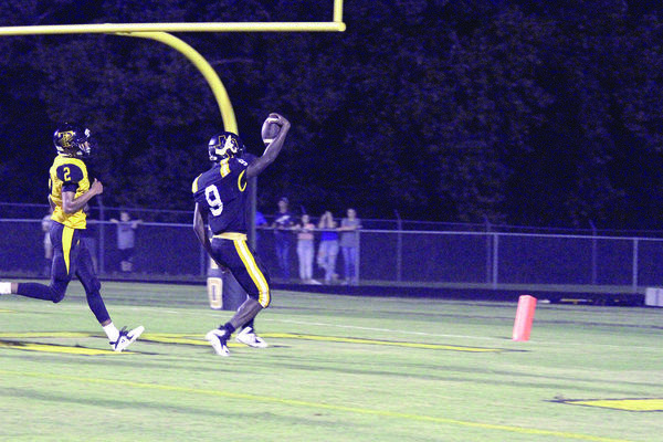 Photos by Beverly Milner Aaron Skinner, Alto Yellowjacket No. 9, scores a touchdown during Friday night's game at home against the Timpson Bears.