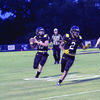 No. 10 Harmon West looking for an open receiver while No. 2 Vi'Dareous High blocks and offers coverage during Alto's first home game on Friday, Sept. 7.