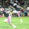 Photo by Tara Tatarski Andrew Gates, No. 44, kicks the ball during Friday night's game at Swink Stadium in Rusk as teammates Bryce Driver, No. 18 and No. 16 run support. The Rusk Eagles took on the Athens Hornets for their first home game of the season on Sept. 7.  Rusk dominated the score board through most of the game, but ultimately fell to Athens in the fourth quarter, losing by just one point. The Eagles will travel to Palestine on Friday, Sept. 14 to take on the Wildcats. Game play will begin at 7:30 p.m.
