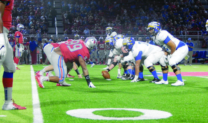 Photo by Josie Fox The Jacksonville Indians square off against the Henderson Lions at Lion Stadium on Friday night.