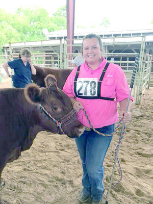 Courtesy Photo Brooklyn Hooker of Jacksonville FFA received first place for her Red Angus heifer, Red Lazy MC Kuruba, during the livestock show held during the East Texas State Fair in Tyler.