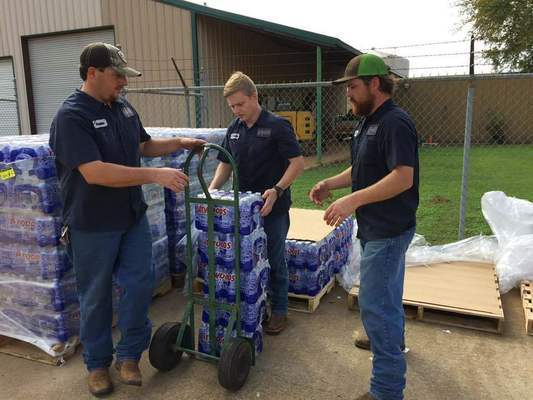 Craft-Turney field personnel get ready to distribute bottles of water to customers affected in the do not use water notice issued by the TCEQ today. Photo by John Hawkins