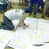 Photo by John Hawkins TCEQ officials scour maps of the Craft-Turney Water Supply Corp.'s service area during their investigation into the recently reported water contaminants.