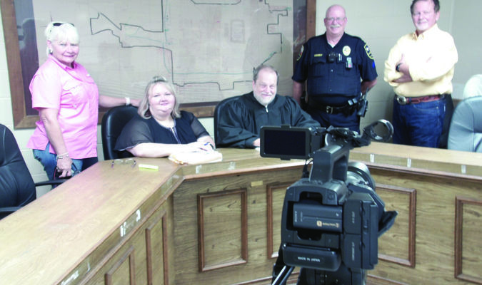 Photo by Cristin Parker Representatives of Cooperative Video Services, pictured far left and far right, take a moment for a snapshot with Rusk Municipal Court staff clerk Angela Rios, Judge Forrest Phifer and bailiff Sergeant Earl Dominy during the making of a training video featuring Rusk Municipal Court.