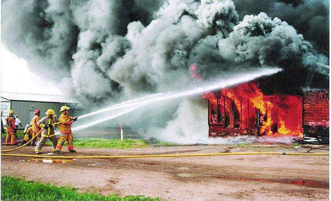 Photo courtesy Bullard Fire Dept.'s website Bullard firefighters work to extinguish a structure that is fully engulfed in flames.