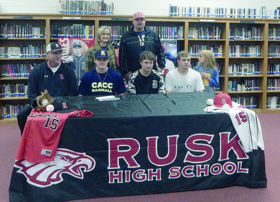 Photo by Josie Fox A signing ceremony was held on Thursday, Nov. 1 at Rusk High School for senior Andrew Gates. Gates, a pitcher for the Rusk Eagles baseball team received a full scholarship to Central Alabama Community College. Gates will start at CACC in the fall 2019 semester. Pictured are, sitting from left to right, Rusk High School coach Robert Ellis, Andrew Gates, Landon Gates, Austin Gates and Lilly Gates. Standing are Andrew's parents, Theresa and Ronny Gates.