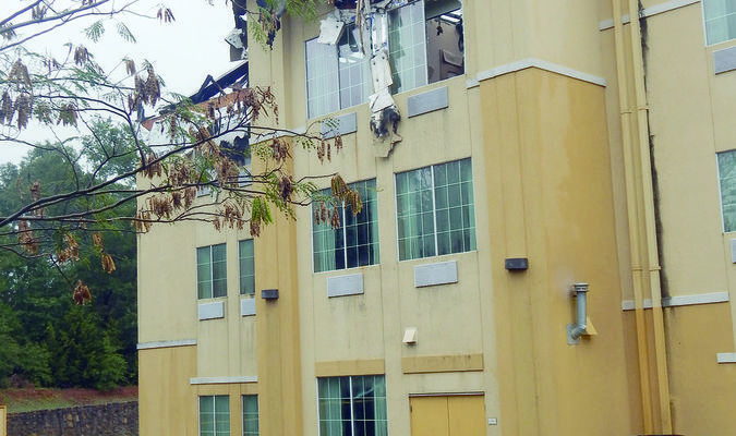 Photo by Courtney Peacock LaQuinta Inn & Suites in Jacksonville sustained the majority of damages to its attic and third floor during a structure fire on Monday morning.