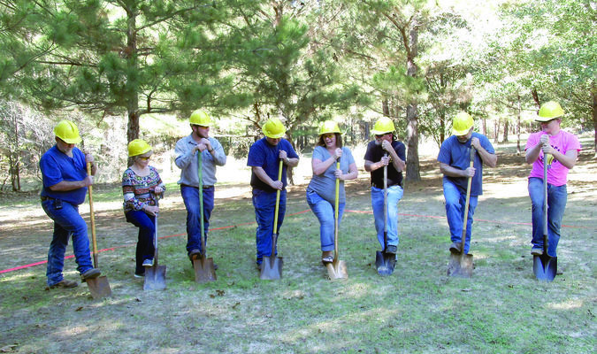 Photo by Cristin Parker Heaven's Stepping Stone Retreat board members and supporters, from left, Terry Black, Nan Glaze, Austin Gwartney, Jason and Amanda Collie, Bruce Robinson, Stanley Dover and Lane Jackson break ground on the Retreat's first cabin on Saturday, Dec. 1, at the retreat in the Alto area. Board members Jerry Ocker and Kelly Collins are not pictured. The retreat will offer free stays to families with children suffering from life-threatening diseases.
