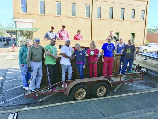 Photo Provided by Heritage Center of Cherokee County Volunteers pose with the disassembled soda fountain bar as they prepare to transport it to its new home at the Heritage Center of Cherokee County in Rusk. The historic bar will be on display during the Christmas Tour of Homes.
