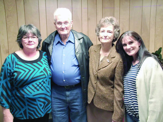 Photo by Cristin Parker County Treasurer Patsy Lassiter, center, with her husband Jack, daughter Jacey Smith, far left, and stepdaughter Darlene Stanley , far right, enjoy Lassiter's retirement party held earlier this month at the Cherokee County Courthouse.
