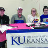 Photo by  Cristin Parker Family and friends gathered on Sunday, Dec. 16 to offer congratulations and well wishes to Rusk Lady Eagle Tatum Goff as she signed her acceptance to to University of Kansas, where she will play softball for the KU Jayhawks.