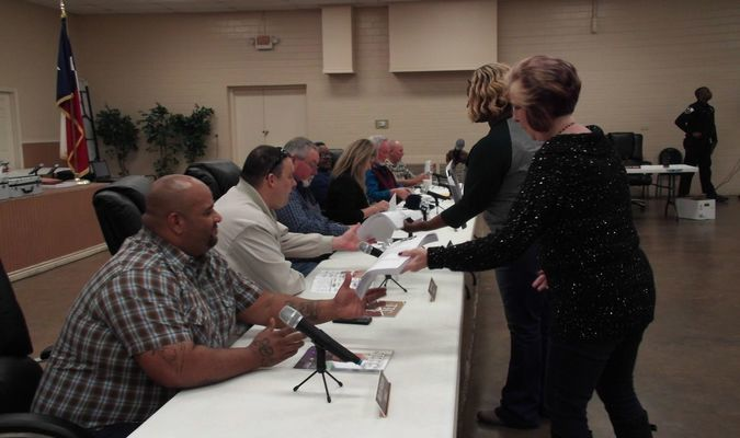 Rusk City Secretary Rosalyn Brown served Councilmen Jan Pate and Ken Ferrara with the petitions bearing the signatures of Rusk voters seeking the pair's removal from office. Rusk clerk Pam Tyer provides the rest of the council members will copies of same. Photo by Cristin Parker
