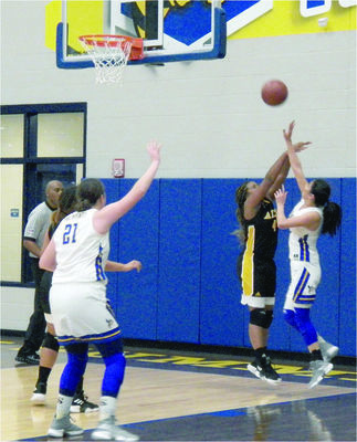 Photo by Michelle Dillon New Summerfield's Leslie Guzman takes a shot against Alto Lady Jacket defender Makayla Black during the first league game Friday, Jan. 4.