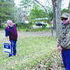 Photo by Cristin Parker Rusk District 5 Councilman Jan Pate, left, and District 5 resident Bill Holland measure the distance between the edge of the pavement on Euclid Street to a yard sign placed along the street last week, to make sure it's not in the public right-of-way. Councilman Pate and Rusk City Manager Jim Dunaway agreed the proper placement of signs along Euclid Street is at least seven feet from the street.