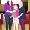 red Douglass Principal Rachel Sherman and student Kenley Penn pose with Lisa Cox while displaying the campus UIL second place award.  Photo by Michelle Dillon