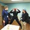 Photo by Josie Fox Rusk Officer Ronald Wherry demonstrates how to do a body search to members Steve Goode, left, and Ben Mims.