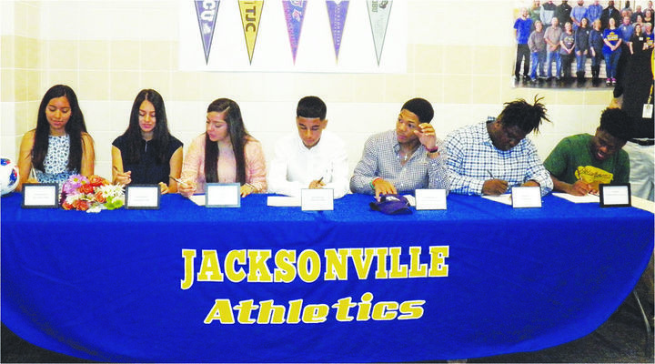 Photo by Michelle Dillon JISD athletes Citalli Medellin, Marina  Villanueva, Alexia Moreier, Raul Arredondo, Deshawn McCuin, Ke'Shoddrevun Fuller and TJ Ratliffe participate in National Signing Day.