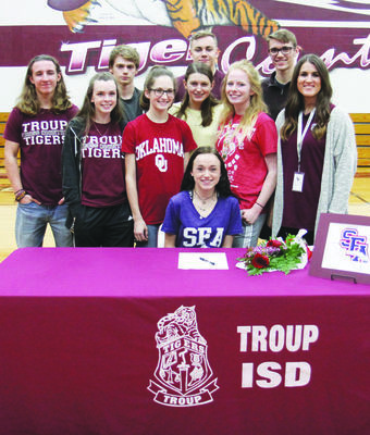 Courtesy Photo TISD athlete Emily Neel, pictured with her teammates, on National Signing Day.