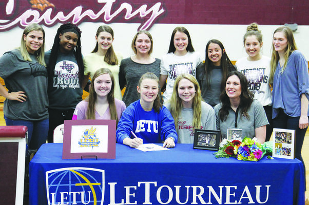 Courtesy Photo Natalie Davenport, pictured with her teammates, on National Signing Day.