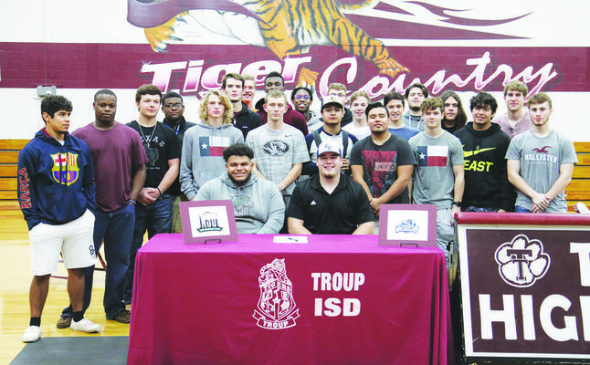 Courtesy Photo Cade Jones and Malik Gilliam, pictured with their teammates, both sign their intent with the colleges of their choice last week.