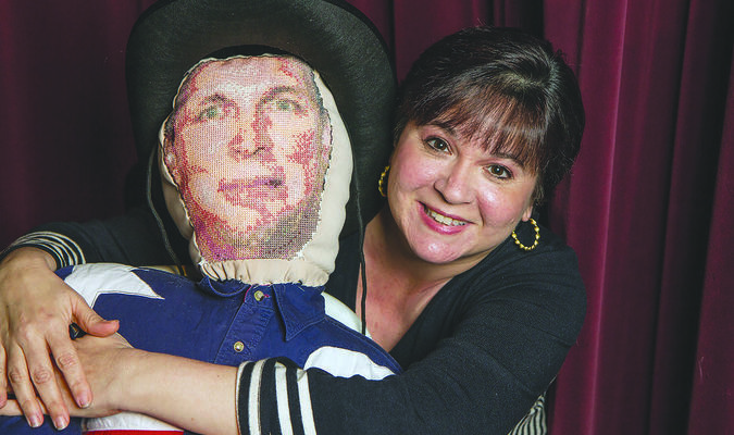 Photo by Heather Beck Playwright and director Minette Bryant poses with the marionette Garth Brooks doll she made for A.M. WWJG. The doll, which will be used in the production, will be raffled off to one lucky theater patron following the final performance of the play. Tickets are now available at the box office for the production.