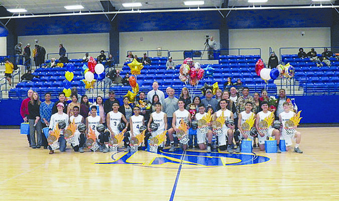 Photo by Michelle Dillon New Summerfield recognized the seniors playing on the varsity basketball team Friday, Feb. 8, which resulted in a celebration of the entire squad. They are pictured here with family members. The team includes (from left) Carson Burns, Jayce Fry, Jose Nunez, Bryant Leon, Juan Hernandez, Luis Martinez, Collin Wilkerson, Elvis Mendoza, Julio Parra, Jose Leon, Alfredo Juarez Rojas and Dakota Stewart.