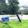 Utility poles were the only casualties of the accident in which traveling industrial equipment pulled down utility wires along U.S. Highway 69.