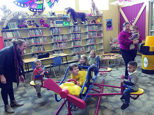 Rusk Public Library's youngest patrons enjoy the airplane in the Children's library room, thanks to Rusk resident Jeanie Swink, who donated the plane and other play ground equipment to the library and Jim Hogg Park.