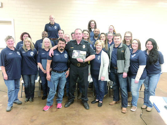 Photo by Megan Dover Chief Joe Williams, center, poses with members of the first Rusk Citizens Police Academy following their graduation ceremony on  Tuesday, Feb. 26.  After receiving their diplomas, the class presented the chief with a plaque of  appreciation and commendation bar for 'outstanding community  service'.