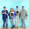 From left, Clay Crushers members Matthew Young, Cassie Loden and John Snider with Club Manager Gregg Loden, show off their shooting awards.