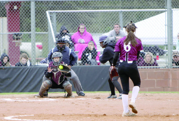 Photo by Shannon Capps Troup's Lindsay Davis puts it over the plate and past the Douglass batter in a game Thursday, March 7. Davis put out 15 batters for the night and Troup won, 3-2.