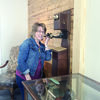 Courtesy Photo Thursday Study Club President Judy Landrum tries out the vintage telephone on display at the Stella Hill Memorial Library in Alto.