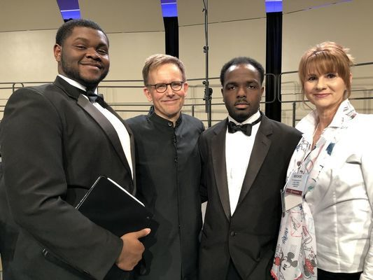 From left, Quavious Johnson, Dr. Craig Hella-Johnson, founding artistic director of Conspirare; Nicholos Trusclair, and Beckie Compton, AC music instructor.