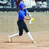 Courtesy photo A Lady Panther team member makes contact with the ball during a recent district softball game. The Lady Panthers are undefeated in district play.