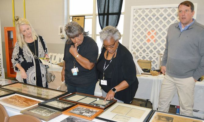 RHS employees and guests enjoy the historical exhibits that were on display at the luncheon.