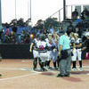 """Photo by Michelle Dillon The team gathers at the plate to welcome """"home"""" Tatum Goff after her homers, with a run batted in, tied the game at five all."""