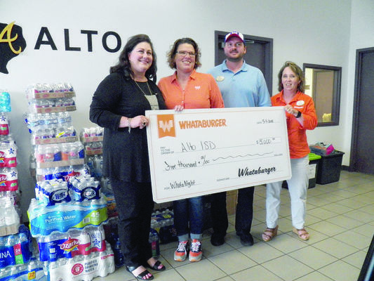 Photo by Michelle Dillon Alto ISD Superintendent Kelly West, far left, accepts a $5,000 donation from Whataburger representatives Jennifer Ruiz, director; Brent Bolder, training manager; and Shelly Lipe, marketing director.