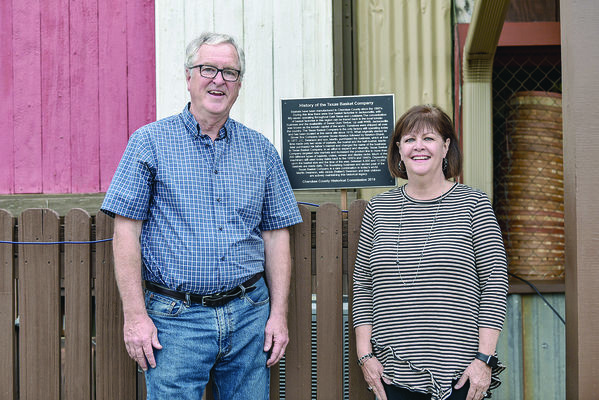 Photo by JTP Photography Texas Basket Company owners Martin and Jackie Swanson get a shot with the historical marker th Cherokee County Historical Commission is in the process of installing at the Jacksonville business.